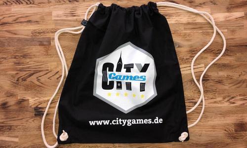 CityGames Leipzig Schüler Tour Sportbeutel schwarz auf Holz